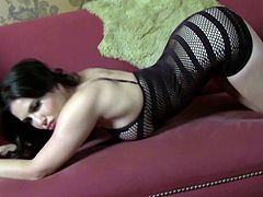 Amazing brunette babe Sunny Leone wearing a fishnet dress is having some good time alone. She strips and fondles herself, and then moves her legs wide apart and fingers her pussy.