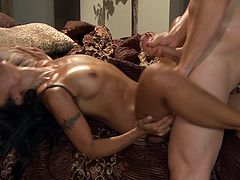 This hot tanned and fetching Asian slut sucks on this dude's hard dick and then rides it like a motherfucker, check it out right here!