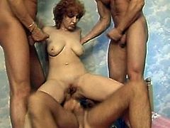 Slutty babe gets demolished during rough and amazing gang bang porn show