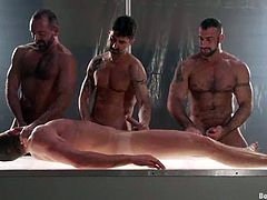Three dudes are going to torture and fuck this poor man! He is going to love what happens to him in this crazy gay porn!