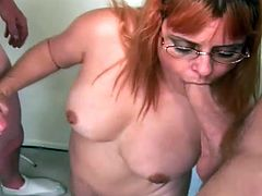Chubby MILF take a dress off and drops to her knees. After that she starts to suck two dicks with pleasure. She also gets her face cum covered massively.