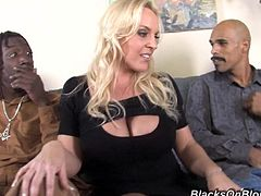 A fucking big titty blonde MILF gets fuckin' pounded hard in this kick-ass gangbang scene right here. Hit play and check it out!
