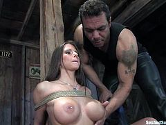 What a smoking hot sex slave is being tortured in this BDSM porn video! Rachel Roxxx is her name and this honey stands any pain and abuse, as long as there is a cock in her twat!