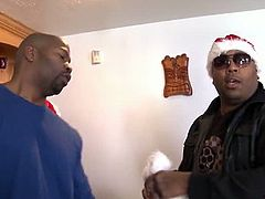 The black dudes have their best X-Mas ever! Blonde mom Alura comes in wearing her sexy and slutty black dress. The guys are satisfied with what they see, especially when she reveals those huge boobs. The mom then kneels and takes care of those black dongs!