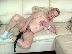 Nasty granny with sagger tits fucks her loose mature cunt with a huge black rubber cock. Have a look at this granny in Old Nanny xxx video!