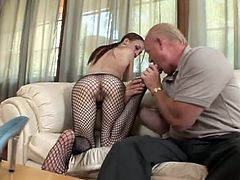 Slim girl in fishnet pantyhose gets her feet licked by old fart. After that she gives him a footjob and sucks old dick.