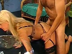 Slutty blonde milf gets facialized like a dirty bitch in the gangbang action.