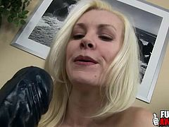 Brandi Edwards sucks on huge black dildo