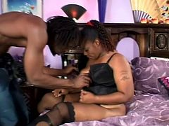 Fat ebony girl in lingerie sucks big black cock. Later on she undresses and gets fucked doggystyle. Then she also gets her mouth filled with cum.