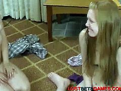 These two cute teens play a card game that includes forfeiting. This refers to taking off pieces of clothing every time it is necessary. The girls have a great time.