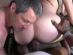 Allie James' husband has a small dick. It is unacceptable for her. So, she has fun with Black dude in front of her husband. She sucks huge dick and gets her incredible pussy fucked hard.