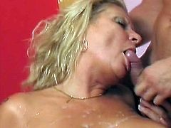 Big tits mature blonde receives a strong dick in each of her holes