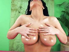 Ashley Robbins with gigantic melons and bald snatch is ready to pose naked all day long