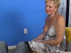 Tracy offers to kick off her blind date with Billy by jerking his cock. This granny knows how to give anyone wanting her satisfied by her wet palms and huge pair of tits.
