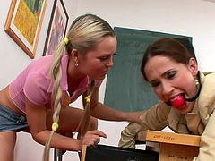 Young dolls are having a great time dominating their hot teacher