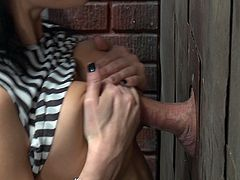 She gets to sucking on that mystery cock and fucks it through the wall, begging for more and loving it! She can milk that cock through a hole in the wall and still get it done!