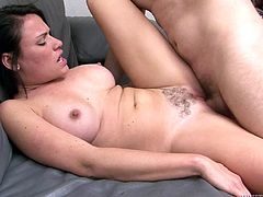 Big-breasted brunette Ashli Ames has hot oral sex with her man. Then they bang in cowgirl and missionary positions and Ashli moans with pleasure all the time.
