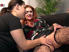 This girls talk about something sitting on the black couch. Then one of them teases other and fingers her twat in Filthy and Fisting xxx video!