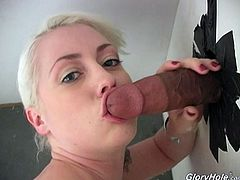 Whens she goes to the porn store and gets into the booth she sucks the first black cock that comes through the gloryhole and swallows his sticky load.