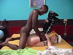 Blonde chick in a bikini and high boots sucks big black cock with pleasure. Her husband has to cope with this because he can't fu