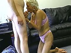 Short-haired blonde granny strips and shows her good tits to some guy. Then she favours the dude with a blowjob and they bang in the reverse cowgirl position.