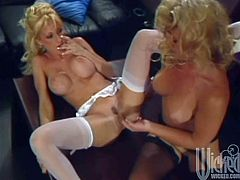 Two blondes in stockings lick each others tits. After that they finger each others pussies and asses. Later on they also use glass dildo.