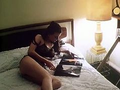 Long haired dark head zealous wifey put on some sexy black lingerie and passionately waited for her horny hubby. Her kitty died for drilling...Take a look at this dirty girlie in The Classic Porn sex clip!