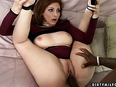 Mature Ginger Blaze with gigantic jugs has some time to rub her fuck hole