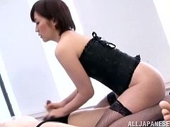 Hot Japanese nurse takes her uniform off. She puts on sexy corset and stockings. This Asian babe gives a blowjob and a handjob. She also pees in guy's mouth.
