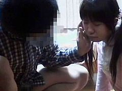 See a cute and provocative brunette Japanese teen giving her tutor a hell of a blowjob. She's a very apt pupil!