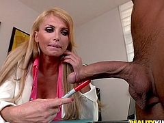 Gorgeous blonde milf Taylor Wane is playing dirty games with some guy in an office. She strokes the dude's massive dick and then takes it in her shaved vag and gets it drilled like never before.