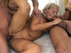 This incredibly perverted mature woman will never miss a chance for a good hard fuck! She rides one dick passionately but she has three more cocks to handle in this hot gangbang action!