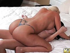 Molly Cavalli with massive melons does striptease before she masturbates with passion