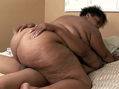 Fat Trixic plays with her pussy lying on a bed. Then she gives a blowjob to Black dude. After that she gets fucked as deep as it possible.