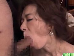 Kei is a hard working mature Japanese women and she takes her work very seriously. A phone call changes everything as she begins to act very weird. She starts being horny and undresses showing a pair of saggy tits and a hot pussy she rubs with lust. How far will she go with her masturbation?