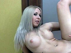 Astounding blonde in a hot solo, fingering well on her creamy pussy