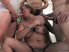Take a look at this hardcore scene where this slutty mature gets gangbanged by three horny fellas that leave her out of breath.