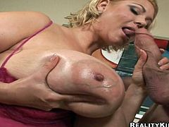 Samantha 38G shows off her huge oiled up tits in close-up scenes. Then she blows a dick expertly and takes rough pussy fucking. It is obvious that a guy fucks Samantha between boobs as well.