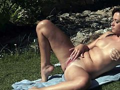 Arousing Tess Lyndon enjoys rubbing her puffy twat in outdoor solo scene
