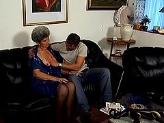 Salacious granny Mrs Stevens is having fun with some dude indoors. She shows her tits to the lad and then takes his boner into her cunt and gets it drilled doggy style and in other positions.