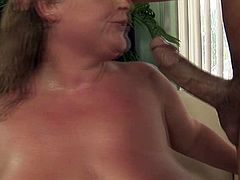 Chunky mature whore in fishnet stockings looks really disturbing. Brave guy fucks her bottomless snatch in missionary and doggystyle positions.