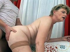 Take a look at this hardcore scene where this horny mature blonde's fucked silly by a guy with a big cock.