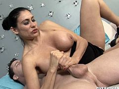 Shelia Marie is a mature slut. She's over 40 and a milf, but she still likes to have fun with the paper boy. She offers him an amazing handjob and lets him cum on her huge tits.