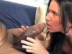 Lustful White chick sucks big black cock and also licks balls. She also has oral sex in a 69 position and then gets fucked in her shaved pussy.