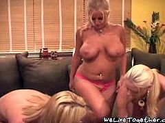 Absolutely stunning blonde babe with big tits and nice shaved pussy gets naked and horny and she is having great lesbian threesome with two more babes