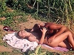 Watch this horny and kinky white bitch with her nice and big titties getting fucked in an open exotic place of africa in The Classic Porn sex clips.