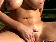 Big-breasted blonde Taylor Vixen wearing a miniskirt is having fun outdoors. She kneads her massive natural tits and then moves her legs wide apart and fingers her pink slit.