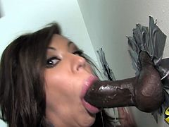 She was horny and went in the private room to masturbate but there she found big black gloryhole cock. She start sucking it and then stick it in pussy.