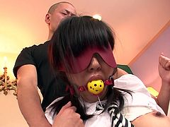 Skanky brunette girl looks sexy wearing college uniform. She has got her mouth shut with gag and her eyes blindfolded. Two perverted Jap jerks toy fuck sassy toy in provocative porn video.
