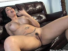 Entertain yourself by watching this long haired brunette, with giant boobs and a nice ass, while she gets nailed hard and moans like a wild animal.